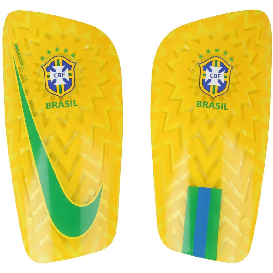 9e39a548491 Caneleira de Futebol da Seleção Brasileira 2018 Mercurial Lite Nike - Adulto
